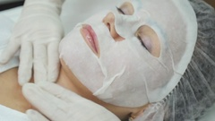 Facial mask applying using brush in Beauty salon. Spa Beautician applying Facial Stock Footage