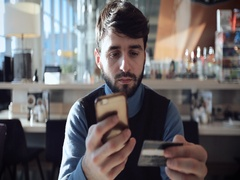 A guy a paid for online shopping with a bank card Stock Footage