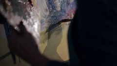 Close-up palette with paint and canvas. artist draws a picture paints a picture Stock Footage