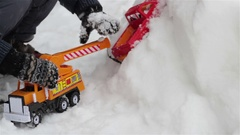 Toy car in the snow Child playing toy cars Stock Footage