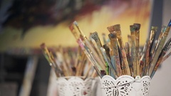 Dirty brush artist in the sunlight. close-up Stock Footage
