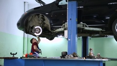 Auto mechanic at work in the garage Stock Footage