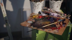 Dirty Palette Knives And Brushes in Art Studio. Art concept. Painting Stock Footage