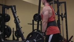 Guy bodybuilder execute exercise in gym Stock Footage