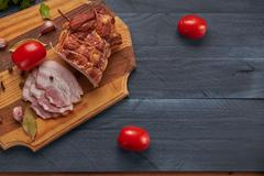 Bacon and seasonings on a wooden table Stock Photos