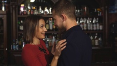 Woman seducing a man in a bar and drinking champagne Stock Footage