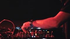 DJ mixing track at the nightclub   Handheld Stock Footage