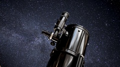 A male astronomer star gazing through a large telescope Stock Footage