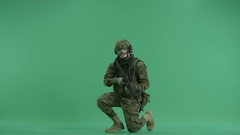Soldier sitting and targeting at green screen Stock Footage