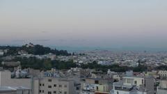 4K Pan Skyline Greece Athens Athina at dusk Europe Stock Footage