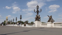 PARIS, FRANCE - AUGUST 2016 Art and traffic over famous Pont Alexandre III Stock Footage