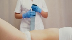 Preparations for mesotherapy procedure. Female belly piercing Stock Footage