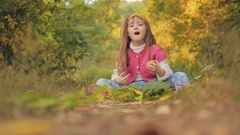 4K Girl Portrait Eating Apple Fruit Autumn Forest View, Child Eats Snack Outdoor Stock Footage