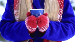 Female hands with hot drink outdoors on winter day Stock Footage