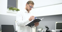 Young scientist working in laboratory. Male researcher Stock Footage