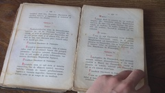 Researcher woman hand turn used page of old bible book historical collection day Stock Footage