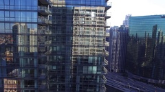Reveal of the Chicago River downtown from behind a high rise building at sunrise Stock Footage