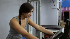 The girl is trains on a exercise bike at the gym Stock Footage