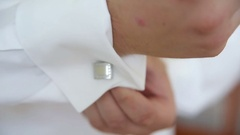 Businessman Fixing Cufflinks his Suit Stock Footage