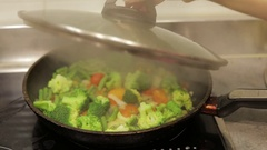 Colorful vegetarian fry meal of delicious asparagus, broccoli and tomato. Stock Footage