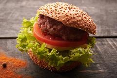 Hamburger on a wooden table Stock Photos