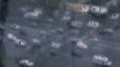 Day traffic Rain Bokeh over glass. Rainy day winter is coming Stock Footage