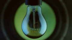 Light bulb hanging speaker frequency move close forward Stock Footage