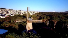 Aerial view of windmill on hills in San Francisco overlooking cityscape 2 Stock Footage