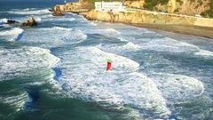 Drone view of wind surfer riding waves on San Francisco beach Stock Footage