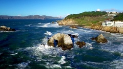 Drone view of choppy ocean and rocks by San Francisco beachside 7 Stock Footage