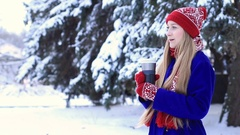 Lovely woman in winter clothes enjoying hot drink Stock Footage