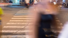 Blurred motion of cars and people on the pedestrian pedestrian passage. Vietnam Stock Footage