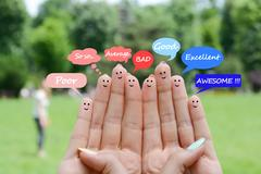 Customer satisfaction scale and testimonials concept with happy human fingers Stock Photos