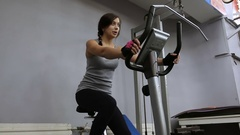 Woman on exercise bicycle Stock Footage