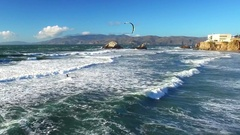 Drone view of wind surfer riding waves on San Francisco beach 3 Stock Footage