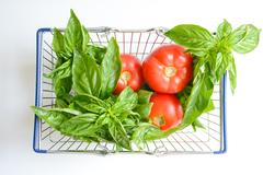 Fresh Vegetables in shopping cart or basket isolated on white background Stock Photos