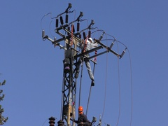 Electricians of the Israeli Electric Co fixing high voltage electrical lines Stock Footage