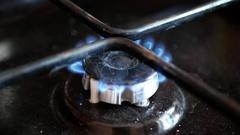 Moka pot coffee maker on a gas cooking hob. Stock Footage