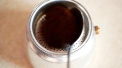 Putting ground coffee into the moka pot coffee maker. Stock Footage