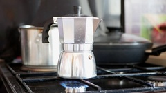 Moka pot coffee maker on a gas cooking hob. Stock Footage