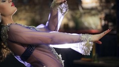 Beautiful traditional female dancer dances belly dancing in restaurant Stock Footage