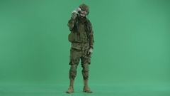 Soldier standing and holding money at green screen Stock Footage