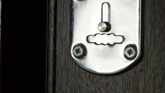 Key sliding into lock and locking\ unlocking door. Close-up. Stock Footage