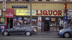 Hollywood Liquor sign on HW Boulevard with cars driving by in Los Angeles Stock Footage