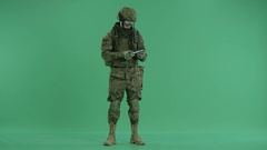 Soldier holding and counting money at green screen Stock Footage