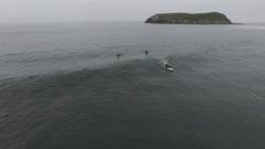 Aerial View Of Surfer Catching A Wave While Friends Watch Stock Footage