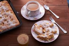 Apple pie charlotte on the wooden table Stock Photos