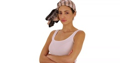 A Hispanic girl poses for a portrait on a white background wearing a bandana Stock Footage