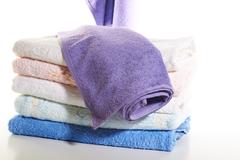 Stack of towels on a white background Stock Photos