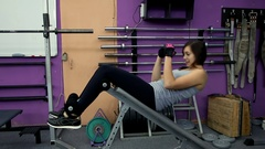 Woman practicing sit-ups on exercise machines at the gym. Woman exercise sit-ups Stock Footage